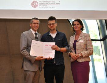 Verleihung OCG Förderpreis an Ph. Frauenthaler durch W. Seyruck und G. Anderst-Kotsis